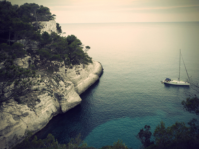 Menorca sea creek witha yacht.
