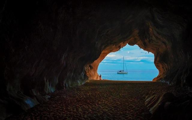 View from a cave of a yacht.